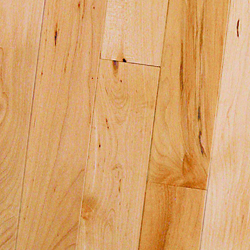 """Maple is a very pale, creamy white color with slight shade differences from board to board. Depending on the grade chosen, Maple flooring can contain minimal to a lot of brownish/black mineral streaks, Clear grade maple has the least of this streaking. Grain will range from uniformly straight lines to curly patterns. Some cuts of Maple flooring will contain graining called """"birdseye."""" because of it's resemblence totiny eyes"""