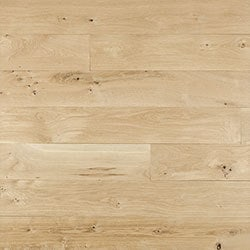 White Oak is another very popular species for hardwood flooring, it is similar to Red Oak, but has a more moderate graining. Coloring of White Oak ranges from golds to browns with gray undertones. Because of it's harder grain White Oak flooring takes stain colors very evenly and accepts more variations of staing without introducing the hints of red you would find in a Red Oak.